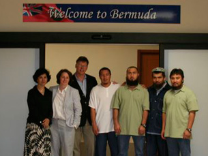 The four Uyghur detainees and their legal team shown on arrival in Bermuda.