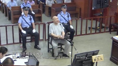 A screen shot of a video showing Memet Abdulla on trial in Urumqi in 2019.