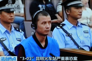 This Chinese TV screen grab shows Turgun Tohtunyaz at a court trial in Kunming, Sept. 12,  2014.