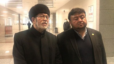 A file photo of Uyghur religious teacher Abduqadir Yapchan (L) who faced an extradition request from China that was thrown out by a court in Istanbul, Turkey on April 8, 2021.