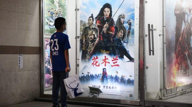 uyghur-boy-looks-mulan-poster-beijing-sept-2020-crop.jpg