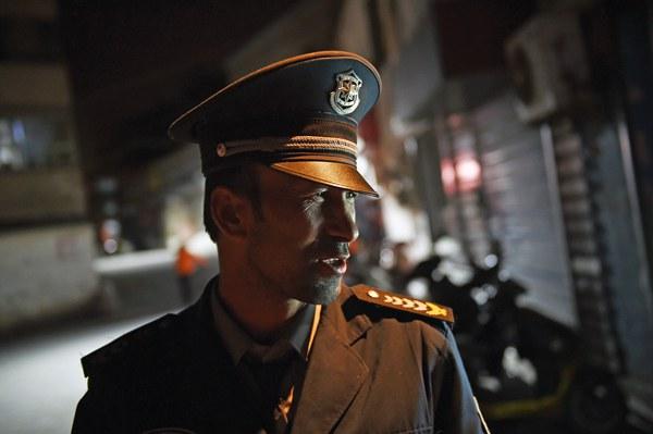 uyghur-police-officer-aksu-apr17-2015.jpg