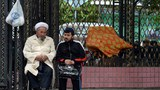 xinjiang-muslim-man-outside-mosque-may-2014.jpg