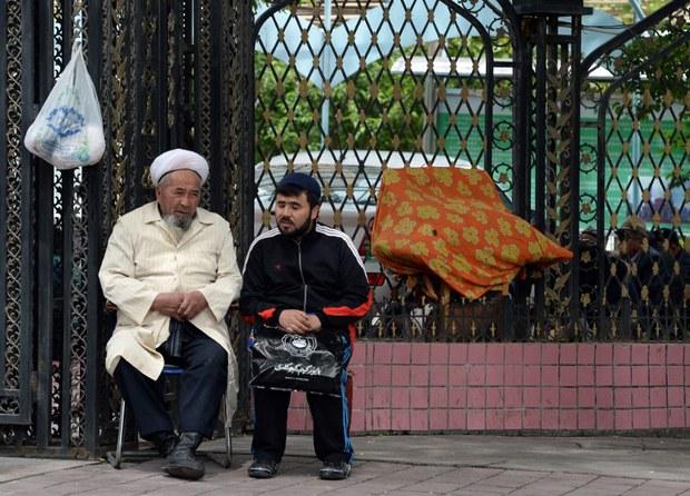 xinjiang-muslim-man-outside-mosque-may-2014.jpg