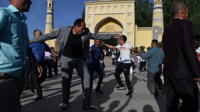 Uyghur men dance after Eid al-Fitr prayers at the Id Kah mosque in Kashgar, in China's Xinjiang region, June 5, 2019.