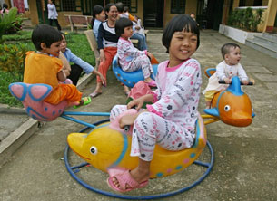 HIV-positive children play at a kindergarten in Hatay, near Hanoi, Vietnam, March 21, 2006.
