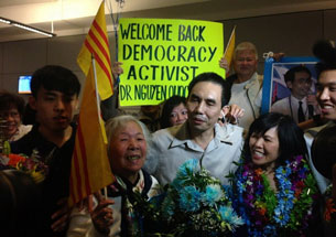 This picture released by the Viet Tan Party shows Nguyen Quoc Quan (C) being welcomed by his family in Los Angeles, Jan. 30, 2013.