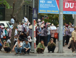 Demonstrators protesting a land dispute gather outside the National Assembly office in Hanoi, April 27, 2011.