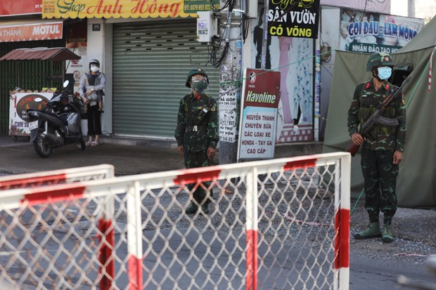Vietnam's Ho Chi Minh City Enters Lockdown, With Armed Soldiers Deployed on the Streets