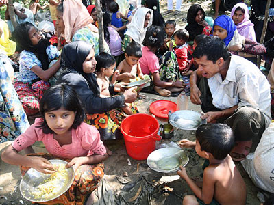 Rohingya Muslim refugees from Myanmar, who entered Bangladesh by boat, rest as they wait to go to refugee camps near Thankhali refugee camp in Ukhia subdistrict, Cox's Bazar, southeastern Bangladesh, Nov. 10, 2017.