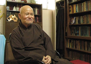 Buddhist monk Thich Quang Do sits inside the Thanh Minh Zen Monastry in Ho Chi Minh City, July 27, 2007.