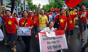 Protesters shout anti-China slogans as they march toward the Chinese Embassy in Hanoi, July 1, 2012.