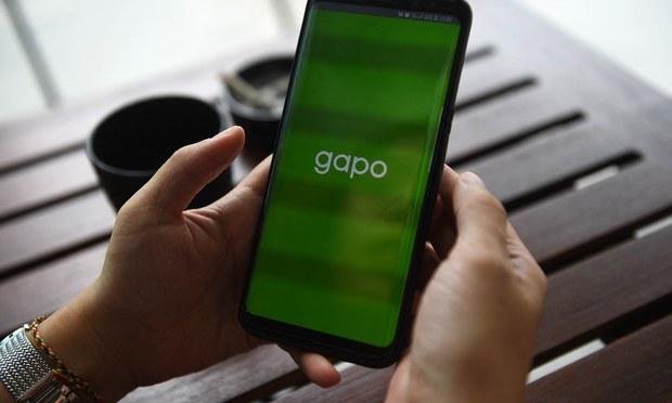 A social media user checks Vietnam's homegrown Gapo app in Hanoi in a July 24, 2019 photo.