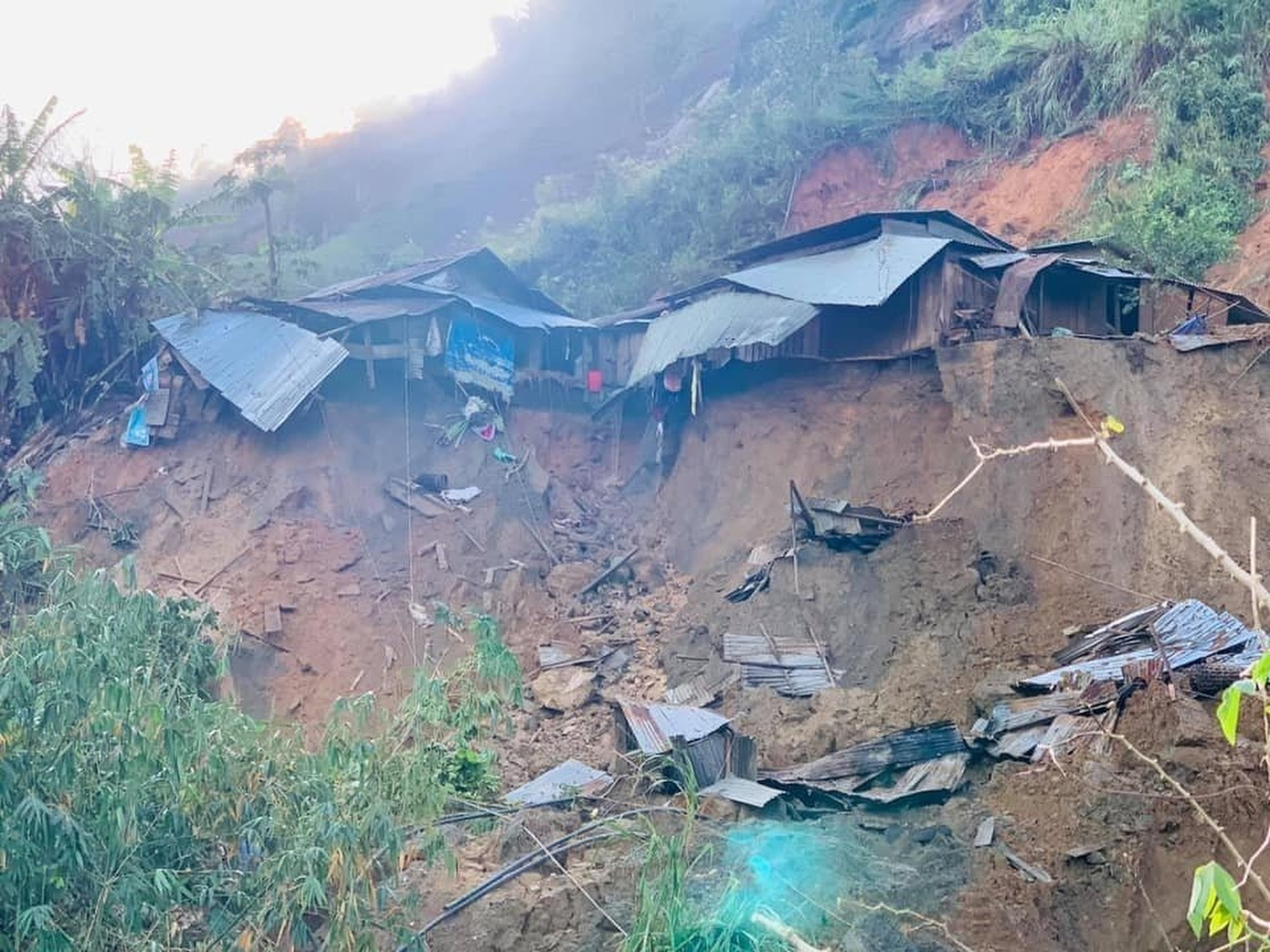 A landslide damages houses in a village in Phuoc Loc district, Quang Nam province, Vietnam Thursday, Oct. 29, 2020. Three separated landslides triggered by Typhoon Molave killed more than a dozen villagers in the province as rescuers scramble to recover more victims.