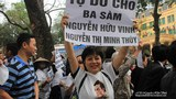 Nguyen Thuy Hanh holds a banner calling for the release of a prisoner of conscience during a protest in Hanoi.