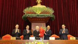 Nguyen Phu Trong (third from left) is congratulated on being named for a third time as general secretary of Vietnam's ruling Communist Party, Jan. 31, 2021.