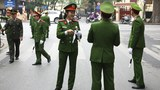 Vietnamese police officers stand outside the North Korean embassy in Hanoi, Vietnam, February 26, 2019.