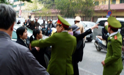 Some women are seen stopped outside a Hanoi courthouse as Cu Huy Ha Vu is tried, April 4, 2011. Credit: AFP