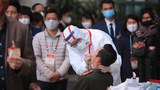 Medical workers test for COVID-19 at Vietnam's Communist Party Congress, Jan. 29, 2021.