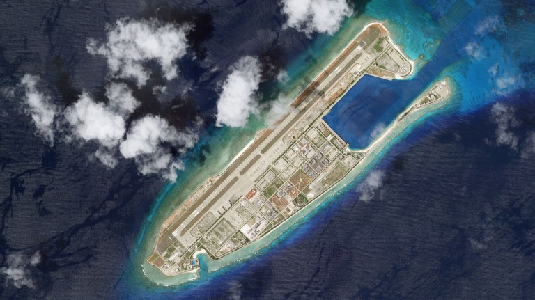 The Chinese-built base at Fiery Cross Reef in the disputed Spratly Islands, pictured in an Aug. 20, 2021, satellite image. Credit: Planet Labs Inc.