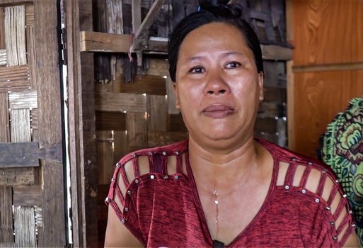 San San Aye weeps when she discusses the plight of her sons on death row. Credit: RFA