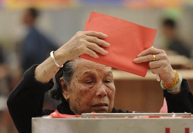 china-woman-voter-wukan-march-2012.jpg