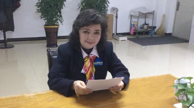 Qelbinur Sidik prepares a lesson in her office in Urumqi, in an undated photo.