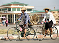 Two women ride bicycles past Myoma Market in Burma's new administrative capital, Naypyidaw on March 28, 2008. Photo: AFP/Khin Maung Win