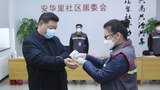Chinese President Xi Jinping wears a protective facemask as a health official checks his body temperature during an inspection of the novel coronavirus pneumonia prevention and control work in Beijing, in photo released by Xinhua News Agency, Feb. 10, 2020.