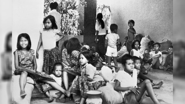 Children_take_refuge_in_French_Embassy_when_Phnom_Penh_fall_under_KR_on_April_17_1975_AFP.jpg