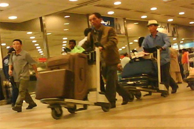 kuwait_worker_departure1_b