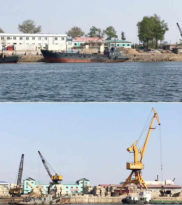 압록강변에서 바라본 북한. 크레인에 적힌 '자력갱생' 구호가 관광객의 눈길을 끌고 있다.