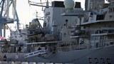 북한이 해상에서 저지르고 있는 정제유의 선박 대 선박 방식의 불법환적을 감시하고 이를 단속하기 위한 훈련에 참가한 영국 해군 소속의 대형 전함 HMS 몽트로스호가 항구에 정박해 있는 모습.