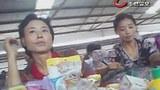 북한 신의주시의 채하시장에서 장사하는 북한 여성.