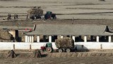 강화군 평화전망대에서 바라본 북한 개풍군 마을에서 가을수확을 끝낸 주민들이 볏짚을 걷어내는 등 농삿일을 하고 있다.