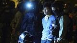 2019年11月19日,香港警方拘捕一名企圖逃離香港理工大學現場的抗議者。(美聯社)