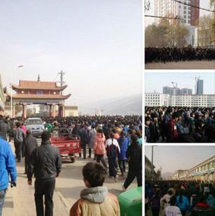 图片: 随后大批僧俗藏人加入,使示威者人数达上万。 (同仁境内受访人提供/记者丹珍)