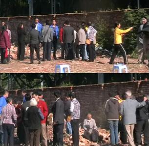 图片:几个大汉阻止村民进入施工现场(村民提供/记者乔龙)
