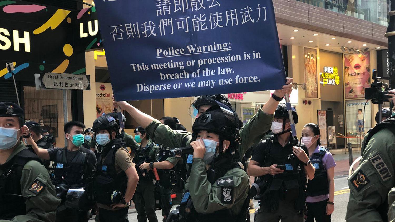 十一当天港警不容许展示标语、不许聚集、不许叫口号。(RFA)