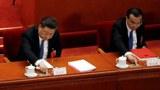 2020年5月28日,中国国家主席习近平和总理李克强在全国人大会议就港版国安法进行表决时按下赞成键。 (路透社)