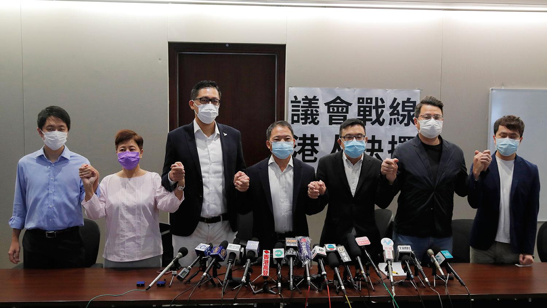 2020年8月20日,香港民主党议员林卓延,胡志伟,涂谨申,尹兆坚等出席新闻发布会。(AP)