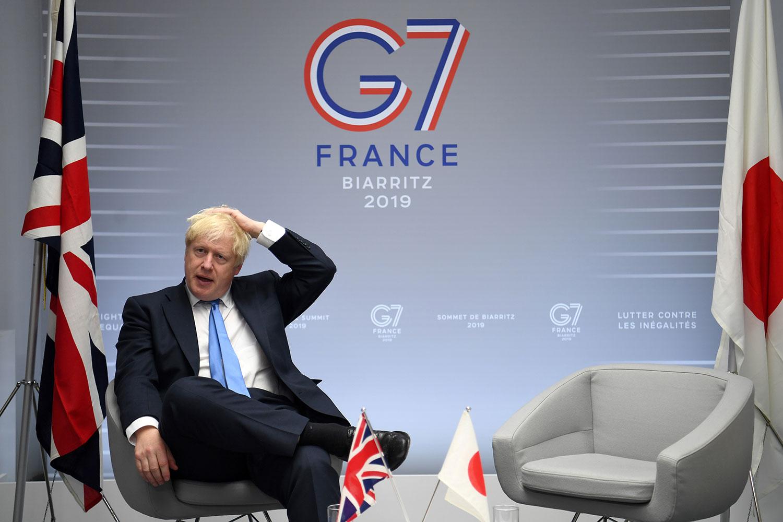 """2019年8月26日,英国首相鲍里斯•约翰逊G7会后表示,将继续致力于维护香港的""""一国两制""""。(法新社)"""