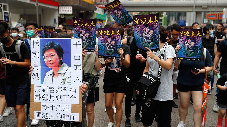 资料图片:2019年8月3日,香港举行反送中大游行。(美联社)