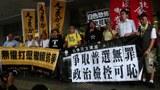 抗议人大831封杀普选,港议员梁国雄被判囚七日。(陈磐提供)