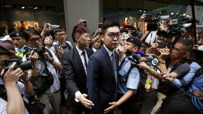 资料图片:2018年8月14日,香港民族党召集人陈浩天在香港外国记者会进行演讲,事件备受国际社会关注。(路透社)