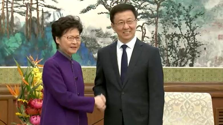 2019年11月6日,中共中央港澳工作协调小组组长韩正接见香港行政长官林郑月娥。(视频截图/路透社)