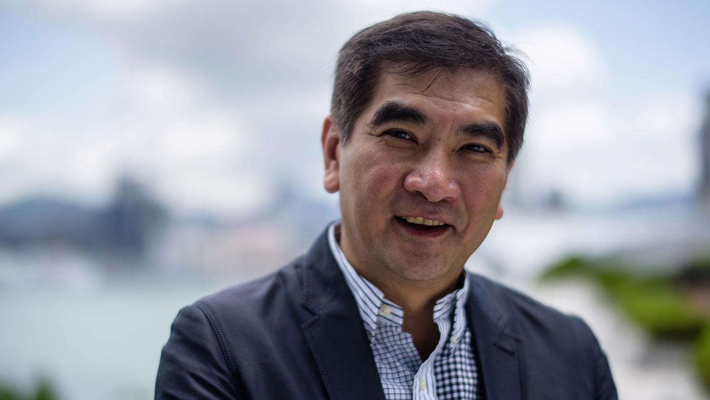 自由党立法会(纺织及制衣界)议员钟国斌受访时认为,有「意见」对香港本地企业影响不大,认为香港商人会懂得在政治夹缝中「走位」。(法新社资料图片)