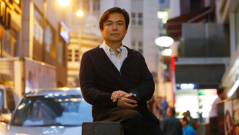 香港资深对冲基金管理人钱志健认为香港经济将逐步走入中国特色社会主义模式。(美联社资料图片)