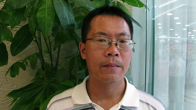 旅美中国人权律师滕彪认为中国民间争取自由的空间极其有限(美联社)