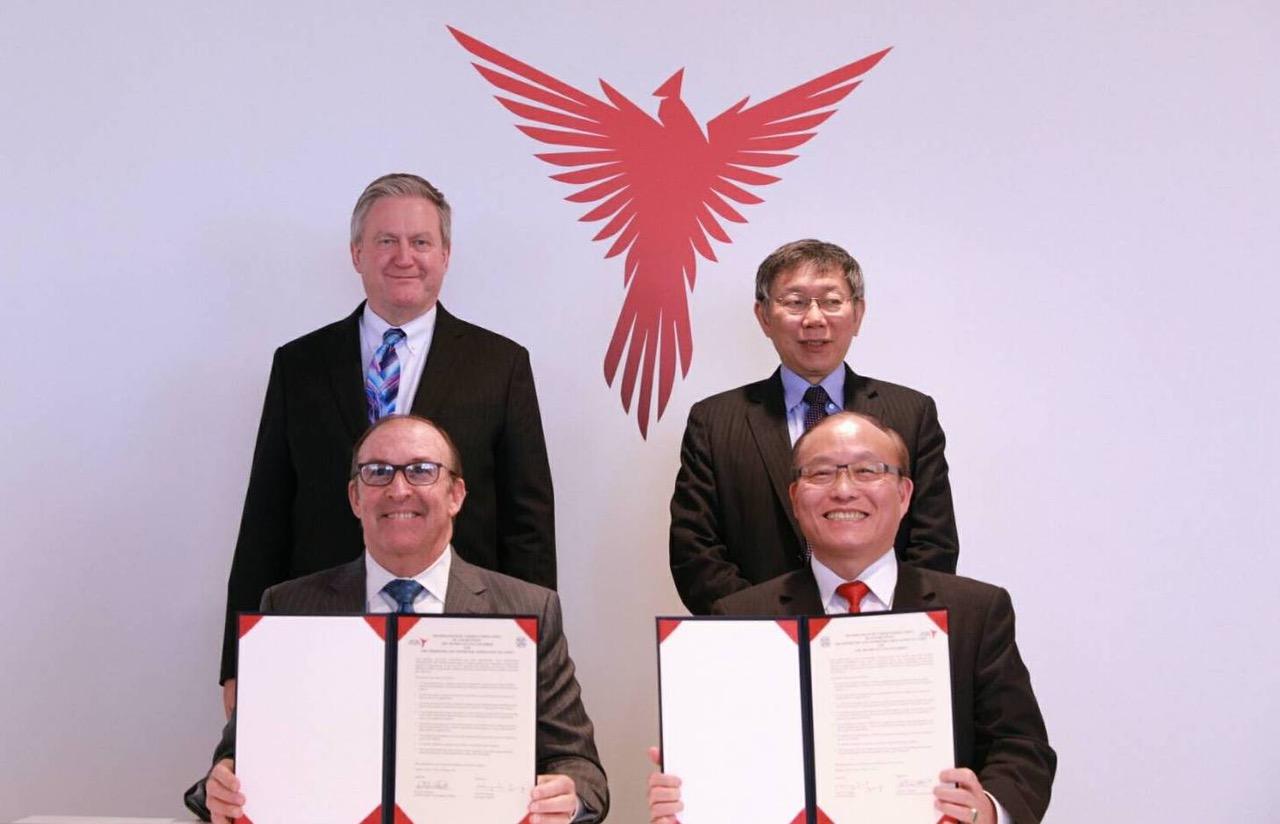 台北市长柯文哲访问美国,和亚特兰大商会签署MOU。(台北市政府提供)